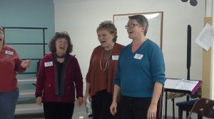 Members practice singing as a quartet during a rehearsal